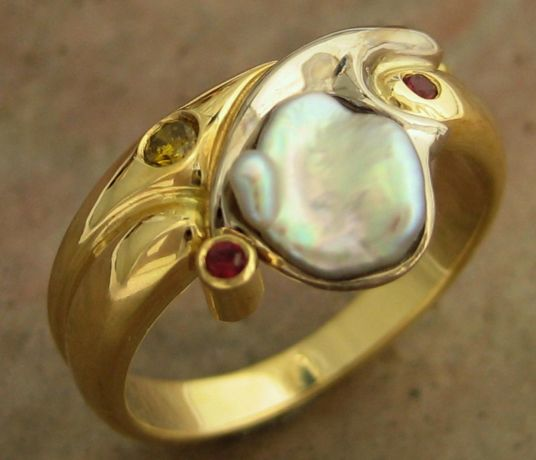 115RWGPSD Ring highly sculptured in 18ct Yellow Gold with 18ct White Gold insert featuring an odd shaped white Japanese Biwa Pearl, pink Sapphires and a yellow Diamond in Brilliant cut
