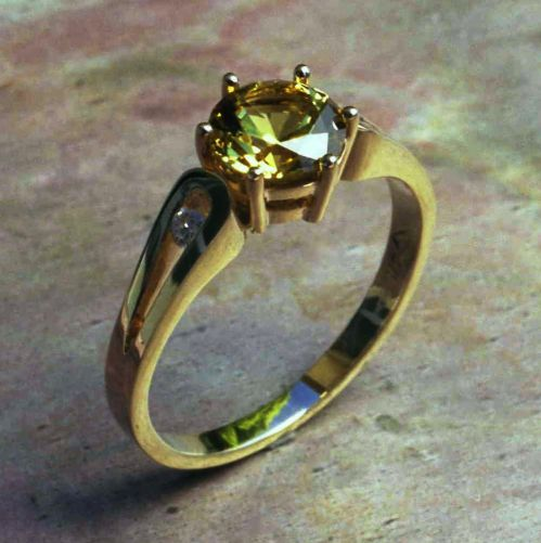 118RGSB Ring in 9ct YEllow Gold loop shank Design featuring a round faceted yellow Sapphire and 2 Diamonds in Brilliant cut channel set into the loops