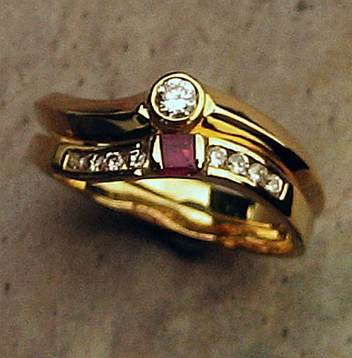 139RGEW Ring Duo in 18ct Yellow Gold fitted eternity and engagement Ring with slight s curve featuring a square Ruby and Diamonds in Brilliant cut bezel set in centre and channel set