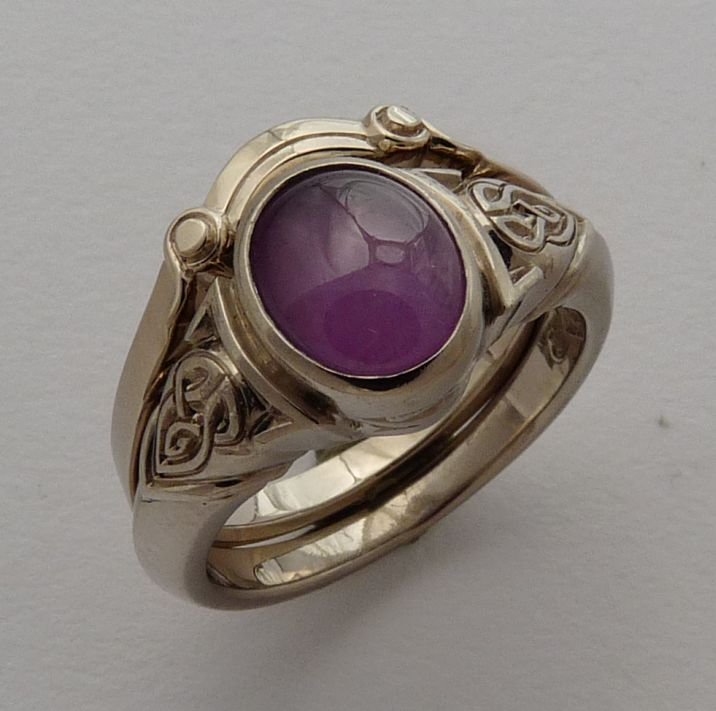 Ring in 18ct White Gold Celtic Knot design featuring oval purple Star Sapphire and fitted wedding Ring