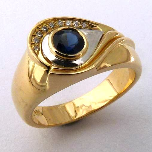 bicoloured ring in 18ct Yellow Gold White Gold with strong symbolism as Eye of Envy Talisman featuring a faceted Royal Blue Australian Sapphire bezel set and Diamonds in Brilliant cut bead set