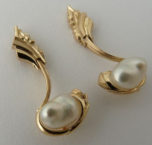Earstud pair carved Waterfall Design in 9ct Yellow Gold featuring white South Sea Pearls