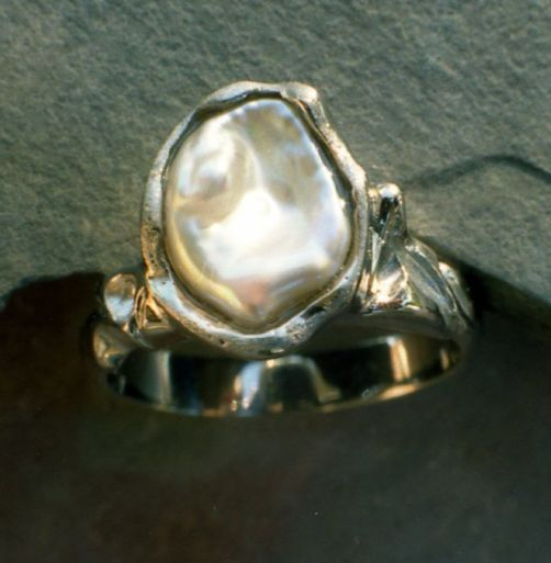 Ring in 950 Palladium carved featuring large odd shaped Freshwater Pearl