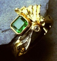 Ring in 18ct Yellow Gold and Palladium with natural emerald in emerald cut