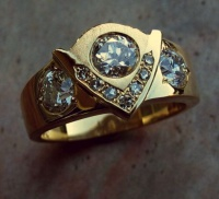 Ring triangle Design in 18k Yellow Gold matt finish detail incorporating 3 Brilliants and 7 single cut Diamonds