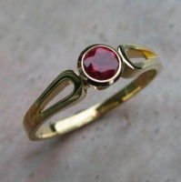 118RGR Ring in 18ct Yellow Gold loop shank Design featuring faceted top pidgeon blood red Ruby
