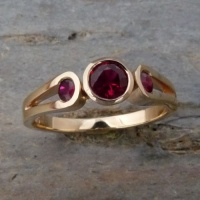 118RGR Ring in 18 ct Yellow Gold loopshank featuring 3 Rubies