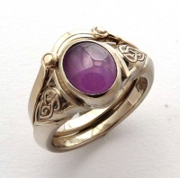167rv_ring_18wg_celtic_knot_design_oval_star_sapphire5575sep2012_and_fitted_wedder73_1736206807