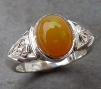 Ring Sterling Silver Celtic Knot design featuring rare oval yellow solid opal