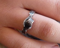Medieval Wedding Betrothal Ring image clasped Hands top view blackened on finger
