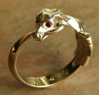 Ouroboros Ring 9ct Yellow Gold facetted garnet eyes