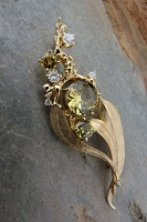Pendant in 18ct Yellow Gold gum leaf design with 3 Sapphires facetted and 5 Brilliants claw set