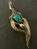 Pendant in 18ct Yellow Gold gum leaf design Australian Opal bezel set