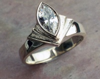69RMFSA Ring in Sterling silver Fan Design Marquise cut Cubic Zirconia in bezel setting with diamond cut surface feature