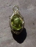 73ES tumbled peridot placed on unpolished earring part