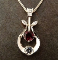 80PWG6S Pendant in Sterling Silver featuring Garnets Cubic Zirconia Art Nouveau Design long bar horseshoe