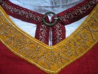 Embroidery taken from the extant tunic of the Holy Roman Emperor 1125-1150 A.D. from Palermo, Kunsthistorischesmuseum Vienna. Stem and satin stitch silk on linen& Underdress 26%